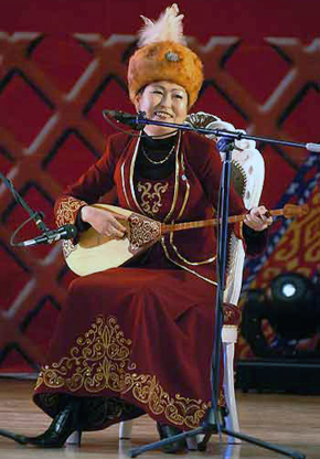 Kazakh singer plays on dombra - kazakh national musical instrument and sings