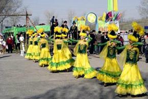 Kazakh girls wearing national dress are dancing at Nauruz celebrations